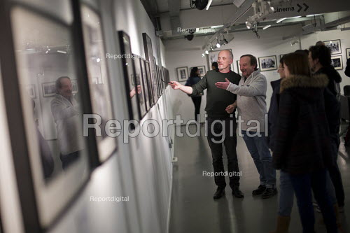 Photographer John Harris talking to Ray Godspeed about the images at the, Still The Enemy Within, miners strike exhibition at Rich Mix, London. - Jess Hurd - 2014-12-05