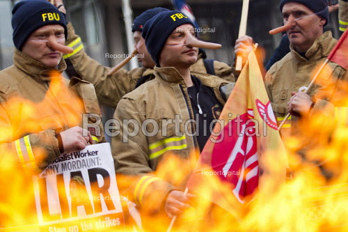 Striking firefighters picket with long Pinocchio noses - they accuse the government of lying in the pensions dispute. London. - Jess Hurd - 2015-02-25