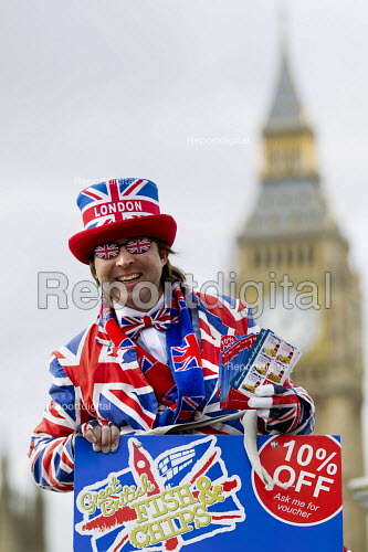 Worker in a Union Jack suit handing out vouchers that give a 10% discount off Great British fish and chips at a nearby restaurant. Westminster Bridge. London. - Jess Hurd - 2015-02-23