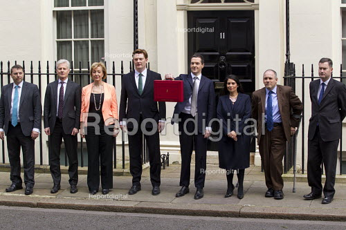 The Chancellor, George Osborne leaves 11 Downing Street to deliver his Budget to Parliament. With his Treasury team. (L-R) Gareth Johnson, Lord Deighton, Andrea Leadsom MP, Danny Alexander MP, The Chancellor of the Exchequer George Osborne, Priti Patel MP, Rob Halfon and David Gauke MP, Westminster, London. - Jess Hurd - 2015-03-18