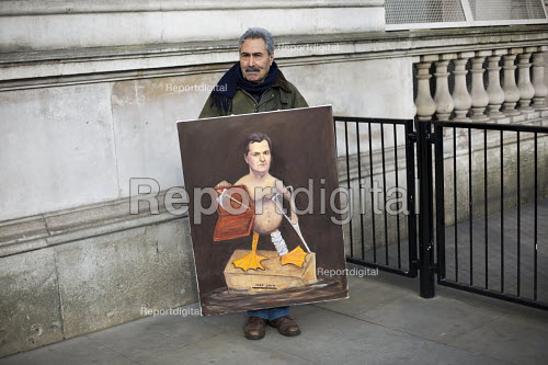 Political, satirical artist and painter Kaya Mar outside Downing Street with a new painting of a naked George Osborne for the Chancellors budget statement. London - Jess Hurd - 2015-03-18