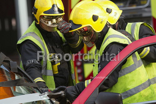 Road Traffic Accident training with White Watch at Paddington Fire Station. Releasing a trapped passenger from a car. London. - Jess Hurd - 2015-03-17