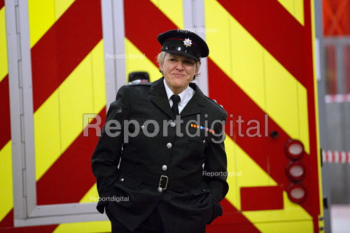 Last role call for Sian Griffiths, White Watch Manager. Retiring after 30 years and one of the first LFB female firefighters. Paddington Fire Station. London. - Jess Hurd - 2015-03-24