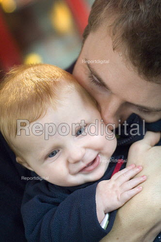 A father blowing raspberries on his sons cheek. - Paul Carter - 2005-10-22