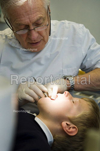 A young boy having his teeth checked by a dentist. - Paul Carter - 2007-03-09