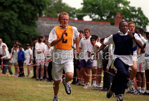 Secondary schoolboys running a race Sports day. - Roy Peters - 1999-07-13