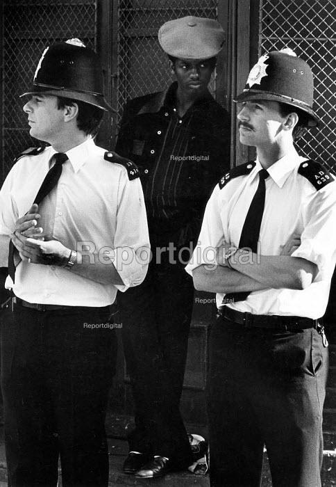 Uneasy truce in All Saints Rd, Notting Hill Carnival. - John Sturrock - 1982-08-29