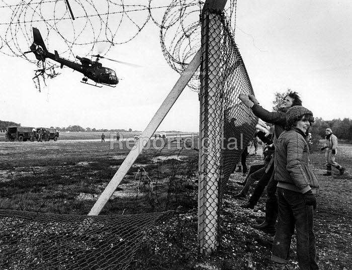 Women remove the fencing, at Greenham Common. - John Sturrock - 1983-10-29