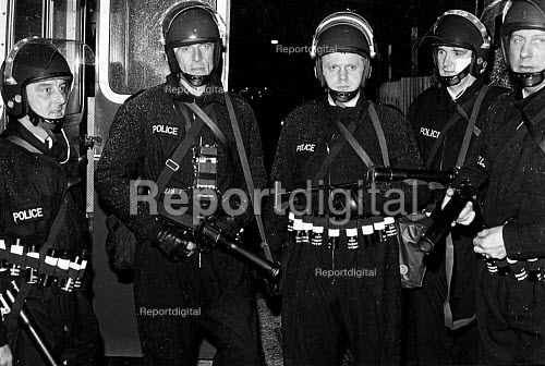 Police tactical firearms group, equipped to fire plastic bullets, deployed visibly for the first time in England during the riot. The riot started after a police raid resulted in the death of Cynthia Jarrett. Broadwater Farm Estate, Tottenham, North London. - John Sturrock - 1985-10-06