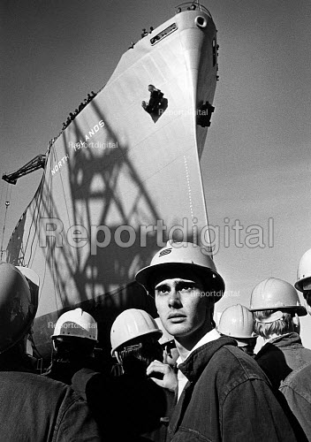 British steel apprentices watching as the last ship to be made at Smith Dock is launched, South bank, Middlesbrough 1986. The yard was closed, shortly after. - John Sturrock - 1986-10-10