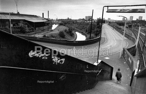 The canals are empty, many factories closed, and the foundries still working for poor wages whilst polluting the atmosphere. Southwick, West Midlands in June 1989. - John Sturrock - 1989-06-20