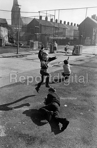 Fence that separates Catholic and Protestant communities East Belfast, Northern Ireland, 1985 behind the wire is the Short Strand a catholic enclave in East Belfast. On this side is the edge of the loyalist Newtownards Road. Children playing - John Sturrock - 1985-07-10
