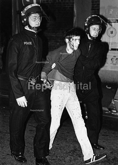 Brixton demonstrator hurt by police truncheons. - John Sturrock - 1985-09-28