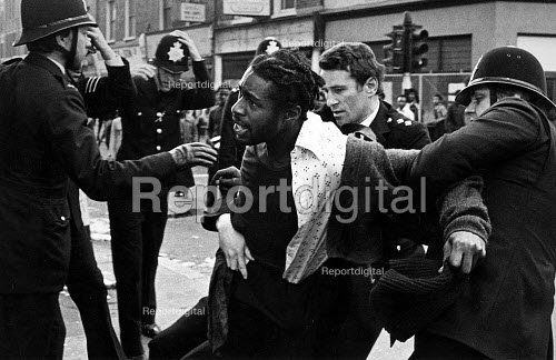 The arrest of a black youth, in Coldharbour Lane, at the start of Sunday afternoon Riot. - John Sturrock - 1981-04-12