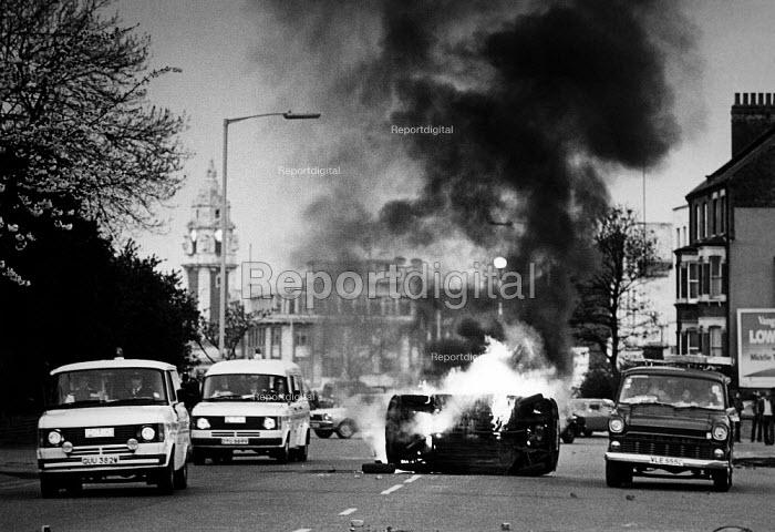 A car burning in Acre Lane, at the Brixton riot. - John Sturrock - 1981-04-12