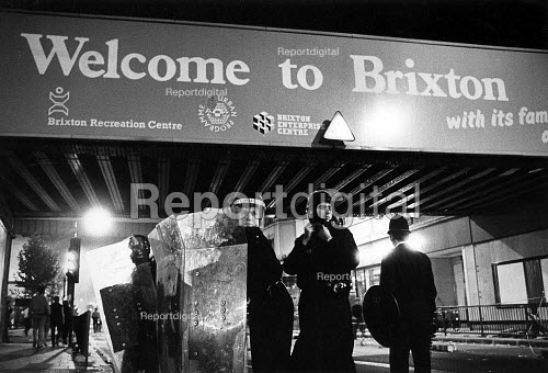 Police occupy Brixton Road after rioting broke out in protest at police shooting of innocent black woman, Dorothy Cherry Groce. - John Sturrock - 1985-09-28