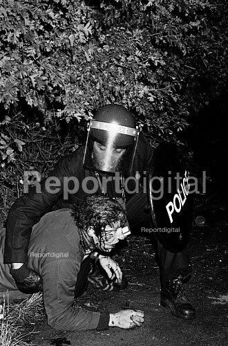Miners Strike. Ian Wright, a member of Hammersmith miners support committee in London, lies battered by police truncheons. He visited the picket line at Maltby pit to observe the strike first hand. South Yorkshire - John Sturrock - 1984-09-24