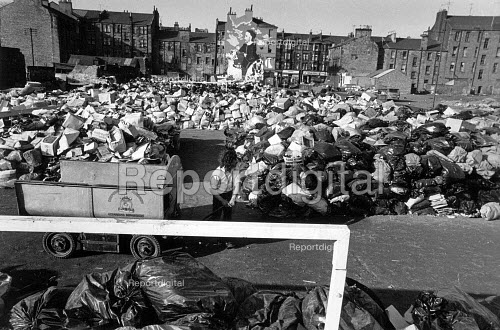 A football pitch covered in piles of rubbish, during the Winter of Discontent refuse collectors strike in Glasgow. - John Sturrock - 1979-01-30