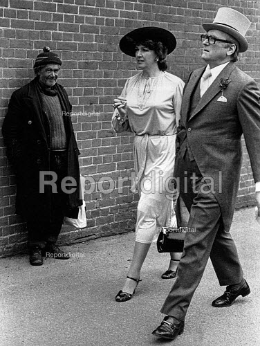 A homeless man looking at the wealthy arriving at Ascot Racecourse in 1981. - John Sturrock - 1981-06-10