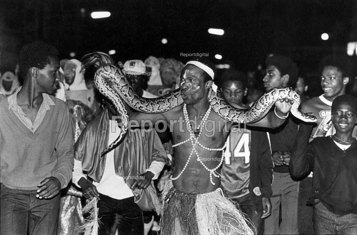 A snake handler at the Notting Hill Carnival, 1981. - John Sturrock - 1981-07-10