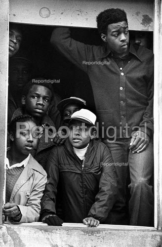 Demonstration for thirteen young black killed in fire at birthday party. Waiting for the protest to start, Deptford, London - John Sturrock - 1981-03-02