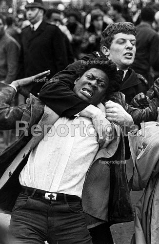 A demonstration for thirteen young blacks killed in fire at birthday party. Trouble at Blackfriars Bridge after police attempts to control the protest, Deptford, London - John Sturrock - 1981-03-02