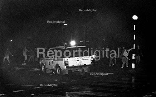 Police Range Rover driving at pickets. Mass picket, Cortonwood pit village, Brampton, Yorkshire - John Sturrock - 1985-02-28