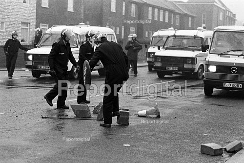 Police remove concrete paving slabs that had been thrown at polce vehicles that were driven at pickets, Police occupy Cortonwood pit village, Yorkshire. - John Sturrock - 1984-11-09