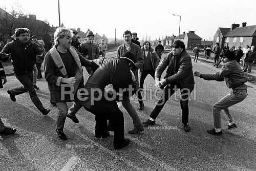 Pickets prevent a policeman arresting a picket, Mass picket in defiance of an injunction, Bentley colliery, Yorkshire Miners Strike. - John Sturrock - 1985-02-14