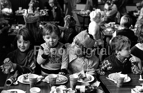 Children enjoying a Christmas party at Frickley colliery welfare with food donated from supporters, South Elmsall, Yorkshire. - John Sturrock - 1984-12-07