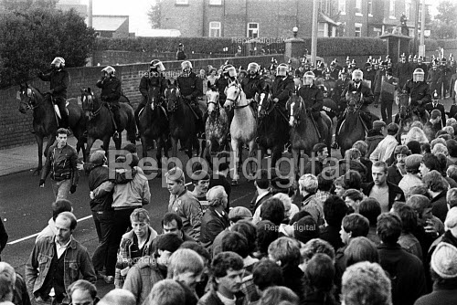 Mounted police clear the way for strikebreakers at Yorkshire Main Colliery, Edlington, South Yorkshire during the miners strike - John Sturrock - 1984-09-06