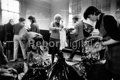 Sorting through clothes donated by supporters of the strike, Shirebrook Miners Welfare, Derbyshire - John Sturrock - 1984-12-10