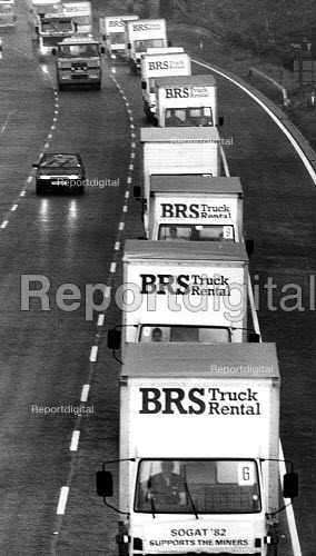 23 3-ton trucks Trucks laden with 100,000 worth of food and goods donated by various trade unions (NGA, SOGAT, USDAW, AUEW, TASS, TGWU), on route from London destined for Barnsley for the miners and their communities, the miners strike - John Harris - 1984-05-29