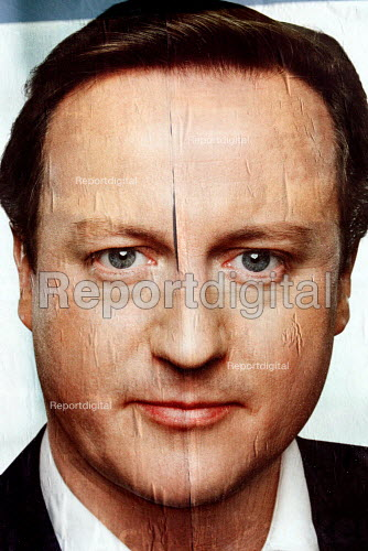 A bill board showing David Cameron�s face cracking and frosty face on a very cold winter morning. The Conservative Party launch their draft manifesto for the upcoming 2010 general election. Luton. - Justin Tallis - 2010-01-04