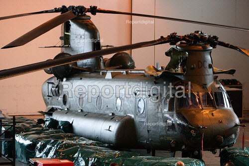 A Chinook helicopter sitting in a hanger at RAF Odiham in Hampshire. - Justin Tallis - 2010-01-13
