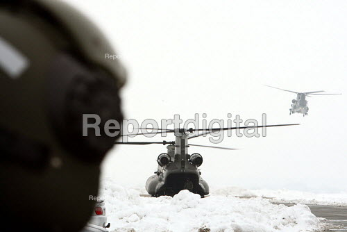 Members of the press wait in the snow to board one of the new Chinook MK3 helicopters at RAF Odiham, Hampshire. - Justin Tallis - 2010-01-13