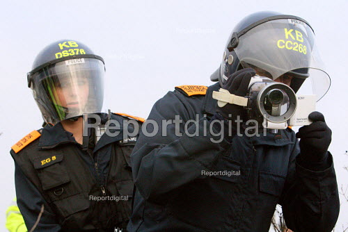Police Evidence Gathering Team (EGT) filming demonstrators on Smash EDO protest on the first year anniversary of the war in Gaza. Direct action against EDO arms manufacturer in Brighton. - Justin Tallis - 2010-01-18