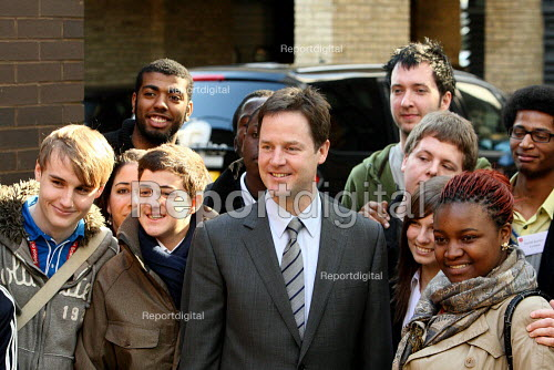 Liberal Democrat leader Nick Clegg MP posing for a photo with young people. - Justin Tallis - 2010-03-01