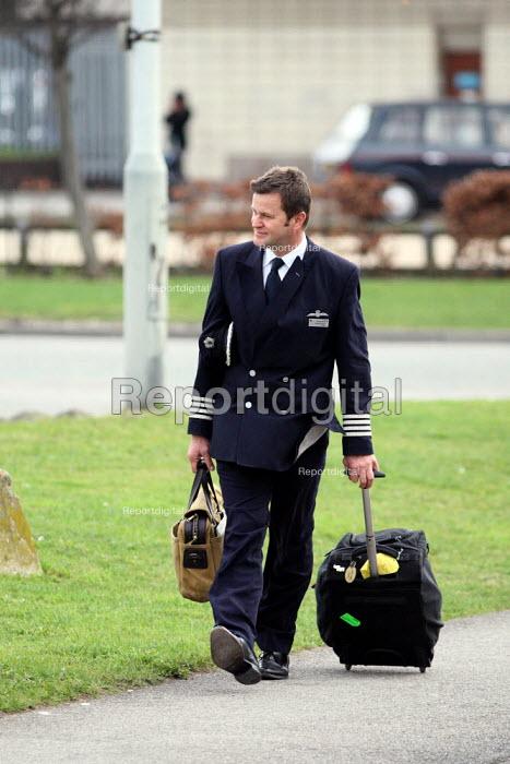 A British Airways Captain walking by London Heathrow Airport. - Justin Tallis - 2010-03-22