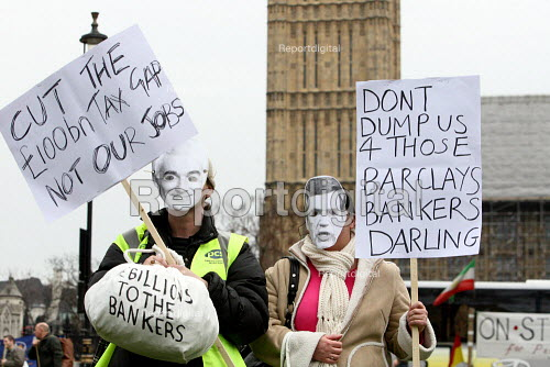 Civil servants with masks of Gordon Brown and Alistair Darling strike on Budget Day to protect jobs and public services. Westminster, London. - Justin Tallis - 2010-03-24