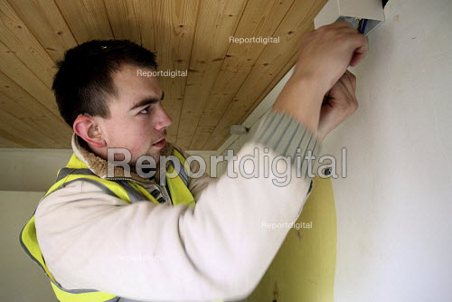 An apprentice with hearing difficulties working towards an NVQ level 2 electrical. Nottingham City Homes, One In A Million Scheme. Nottingham. - Justin Tallis - 2010-03-17