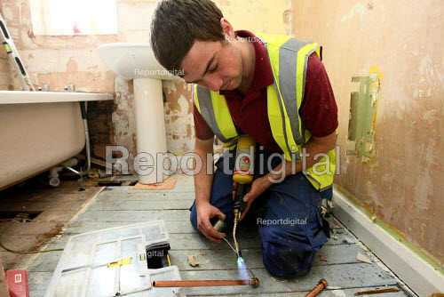 Apprentice joiner working towards his NVQ level 3 gas whilst working for Nottingham City Homes, One In A Million Scheme. Nottingham. - Justin Tallis - 2010-03-17