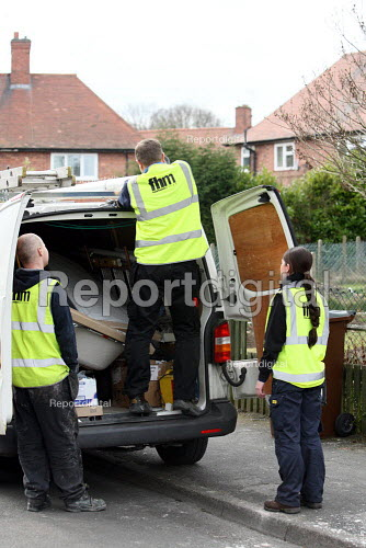 Apprentice working for her NVQ level 2 in plumbing loading up the van at the end of a job. Apprentice plumber working for Nottingham City Homes, One In A Million Scheme. Nottingham. - Justin Tallis - 2010-03-17