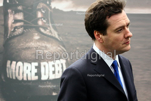 George Osborne speaking to the press as he unveils a new Conservative Party Campaign poster outside Conservative HQ. London. Brown recovery Plan: Jobs Tax More Debt - Justin Tallis - 2010-04-05