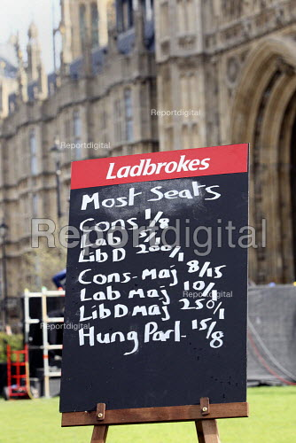 Ladbrokes political betting blackboard outside The Houses of Parliament Westminster, London. - Justin Tallis - 2010-04-06