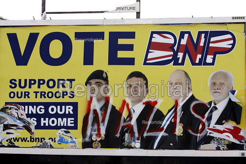 A defaced British National Party bring our troops home billboard Barking. East London. - Justin Tallis - 2010-04-24