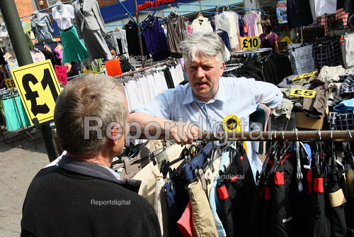 Dominic Carman, Liberal Democrat PPC for Barking, out and about campaigning in the town centre market. East London. - Justin Tallis - 2010-04-24