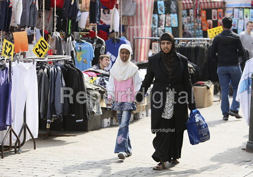 Shoppers going through the stalls at Barking Town Centre Market. East London. - Justin Tallis - 2010-04-24