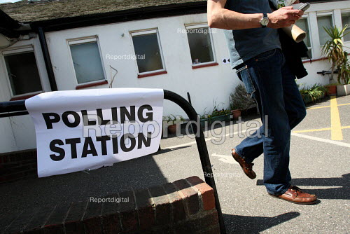A man leaving a polling station after voting in the 2010 General Election. South London. - Justin Tallis - 2010-05-06