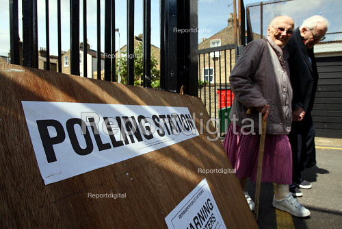 An elderly couple leaving a polling station after voting in the 2010 General Election. South London. - Justin Tallis - 2010-05-06